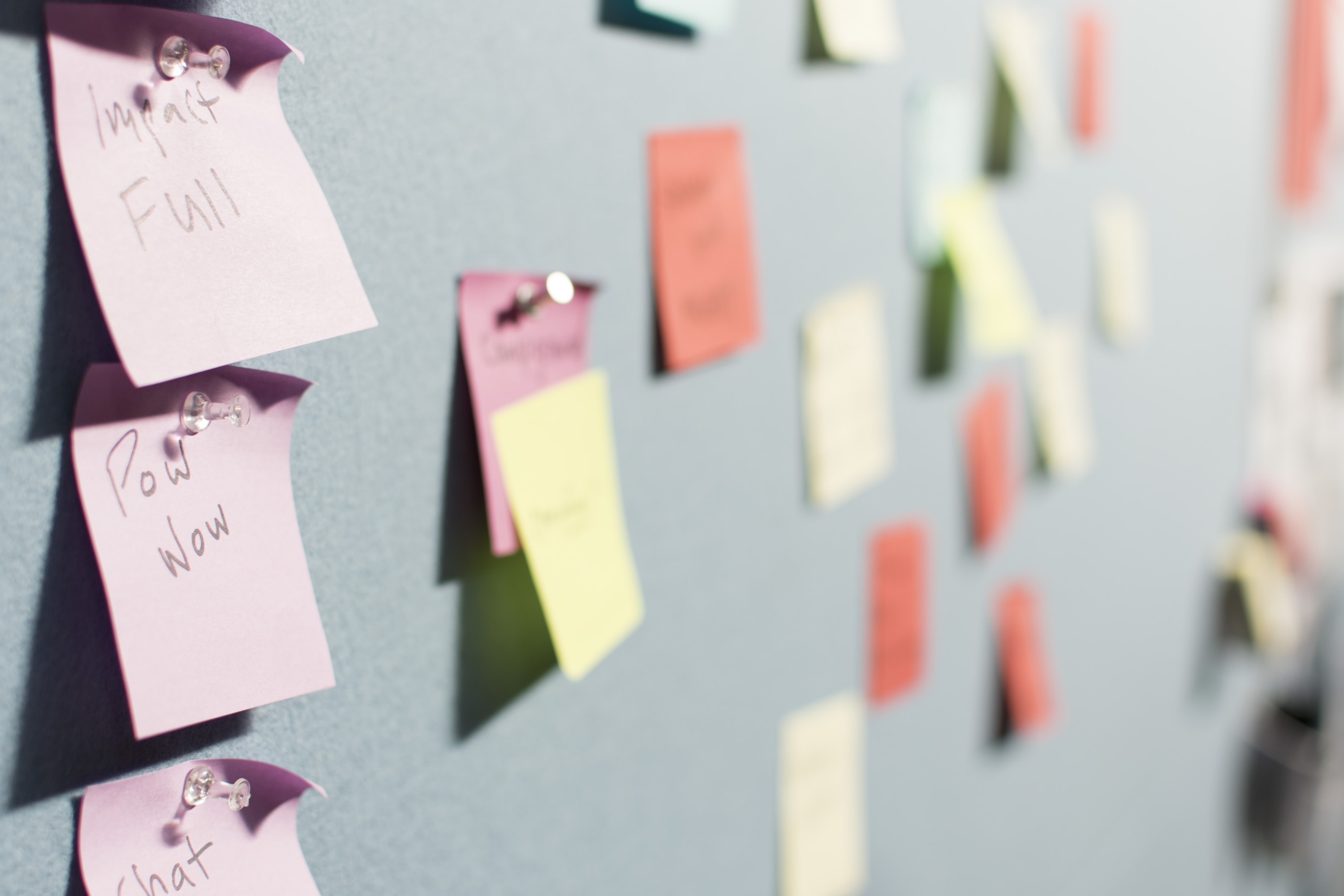 Colorful sticky notes on a gray wall