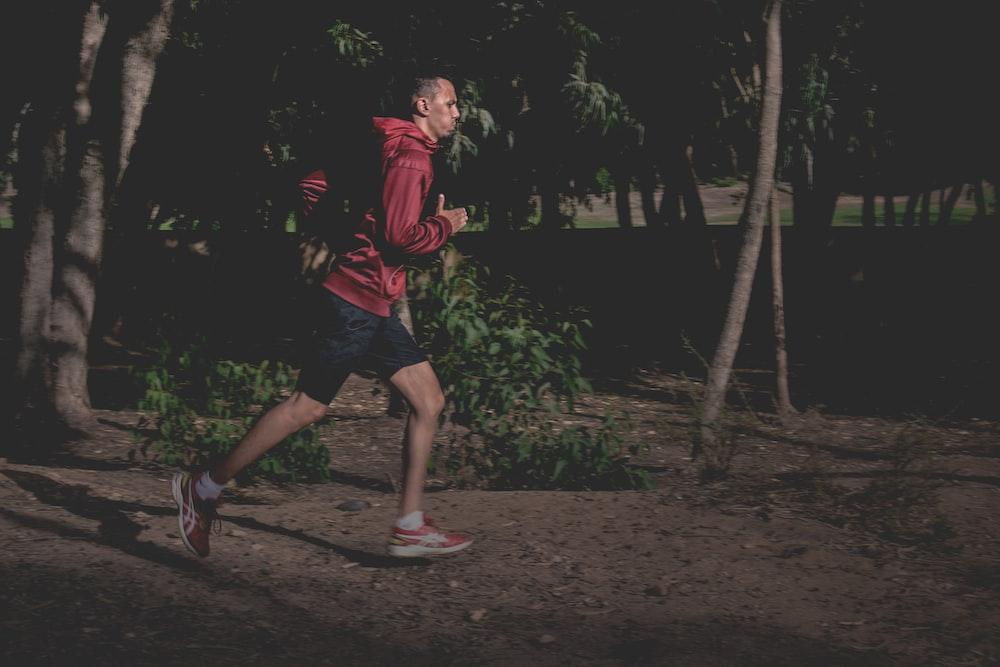 man in red hoodie running