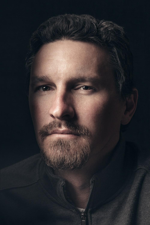 man in black top portrait photo