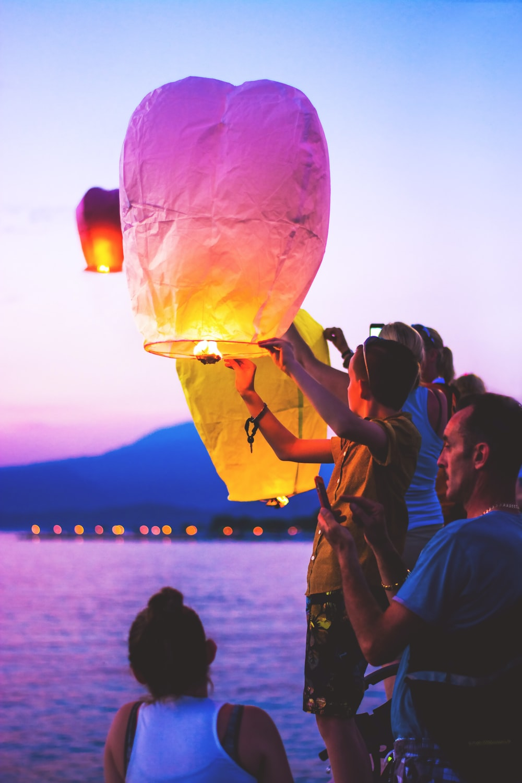 person holding a lantern