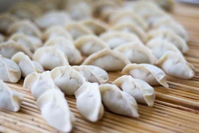 closeup photography of dumplings dumpling teams background