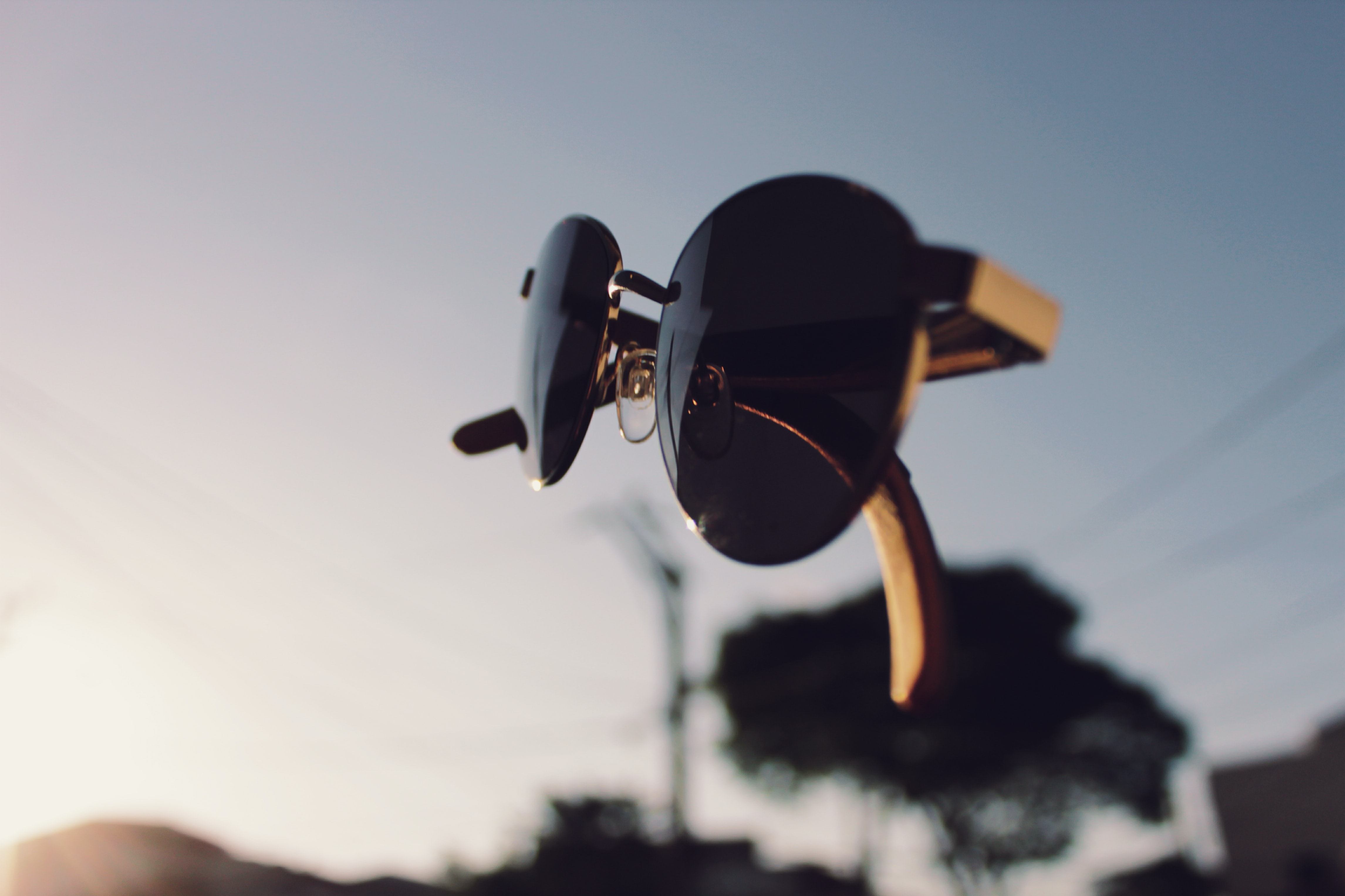 Surreal shot of a pair of sunglasses floating in midair