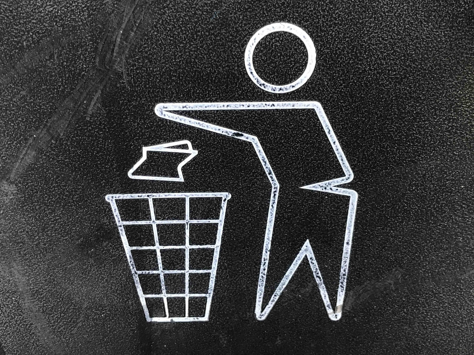 Image of a stylized person throwing trash in a trashcan.