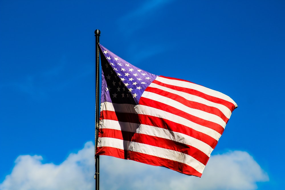 U.S. American flag under clear blue sky