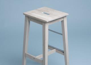 beige wooden bar stool