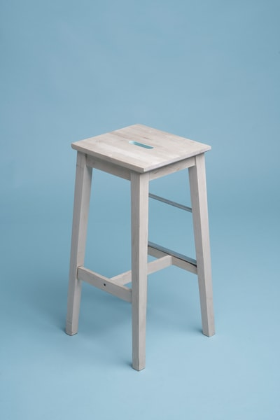 beige wooden bar stool