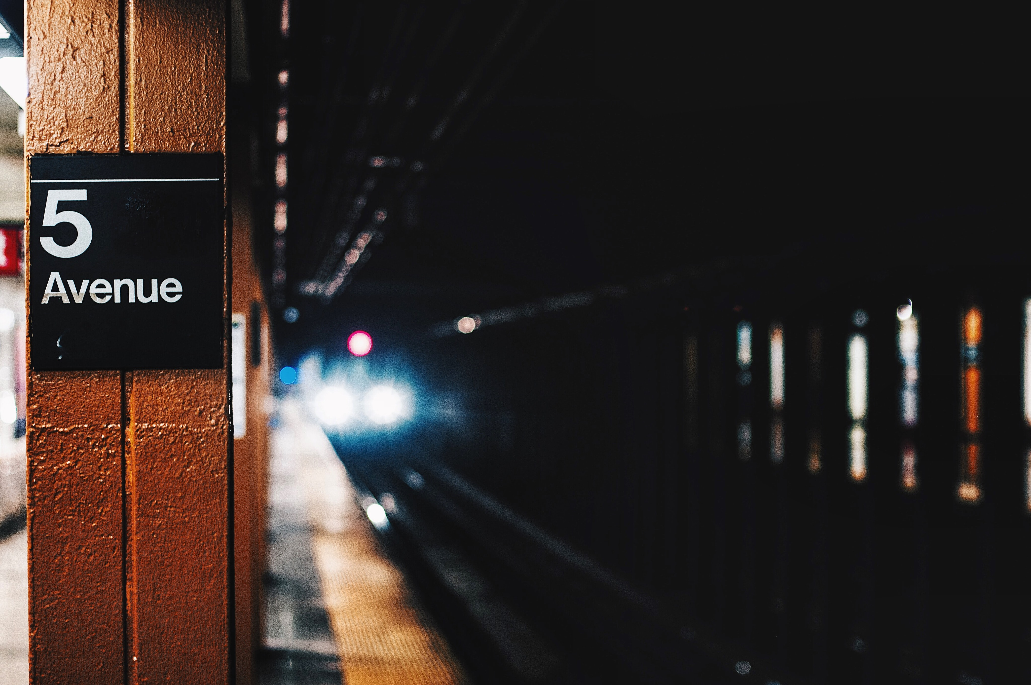 closeup photography of 5 Avenue train tunnel