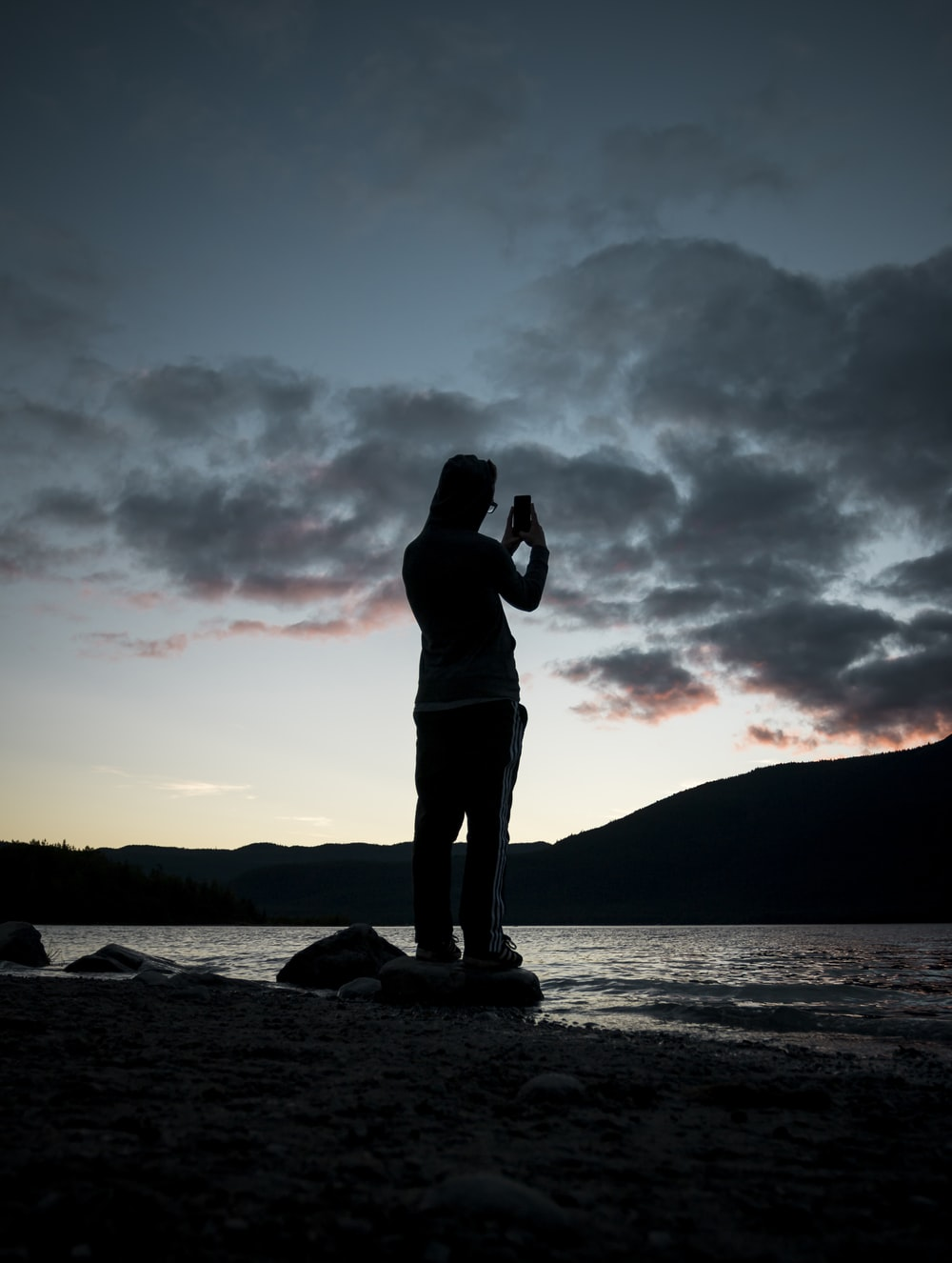 silhouette of person near body of water