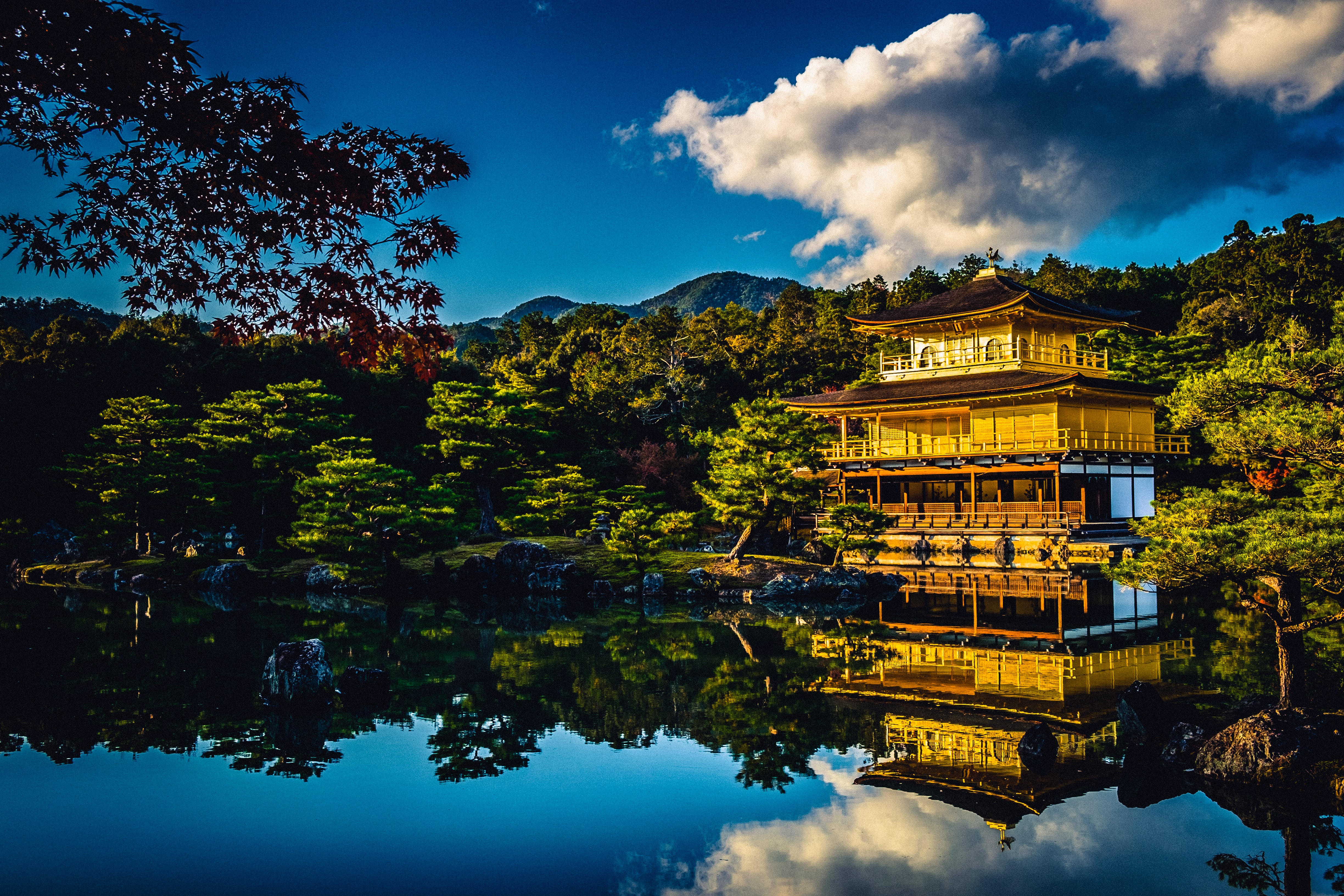 pagoda house near body of water during daytime