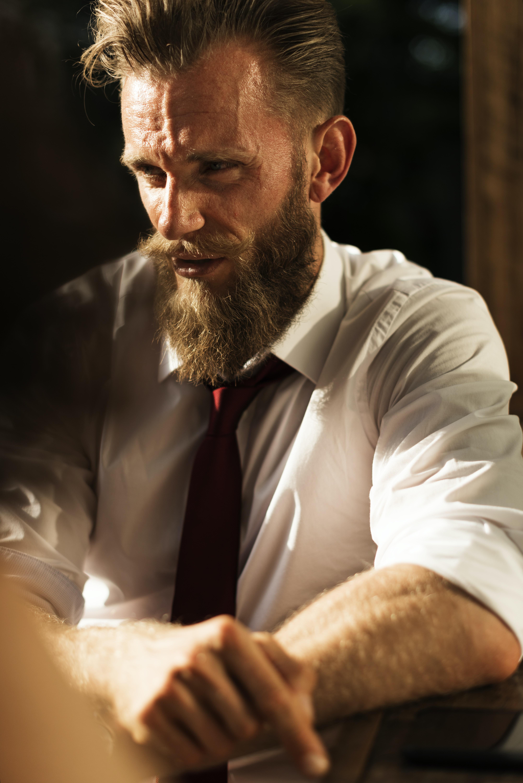 man wearing dress shirt and black necktie
