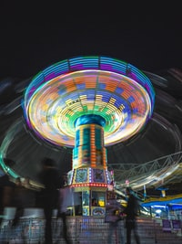 time-lapse photography amusement park ride at night