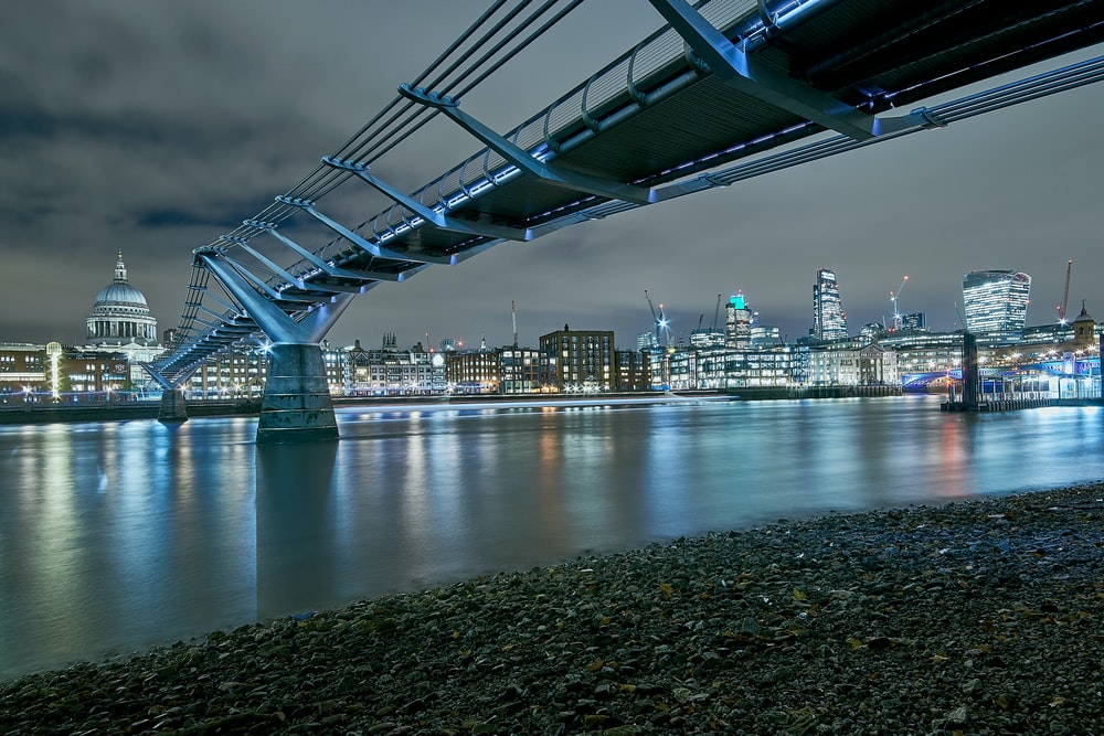 bridge near city scapes at nighttime