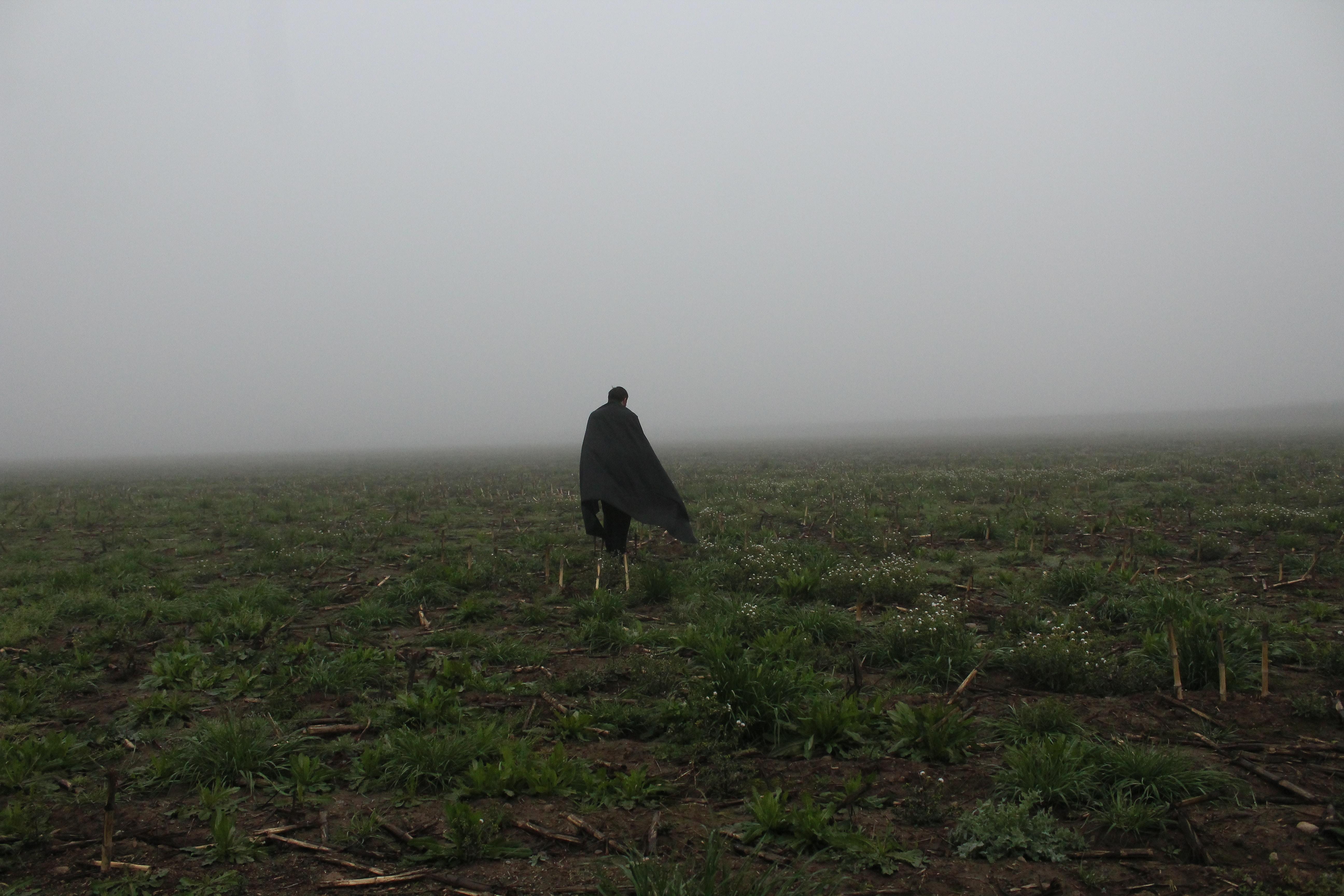 A person walking through a field.