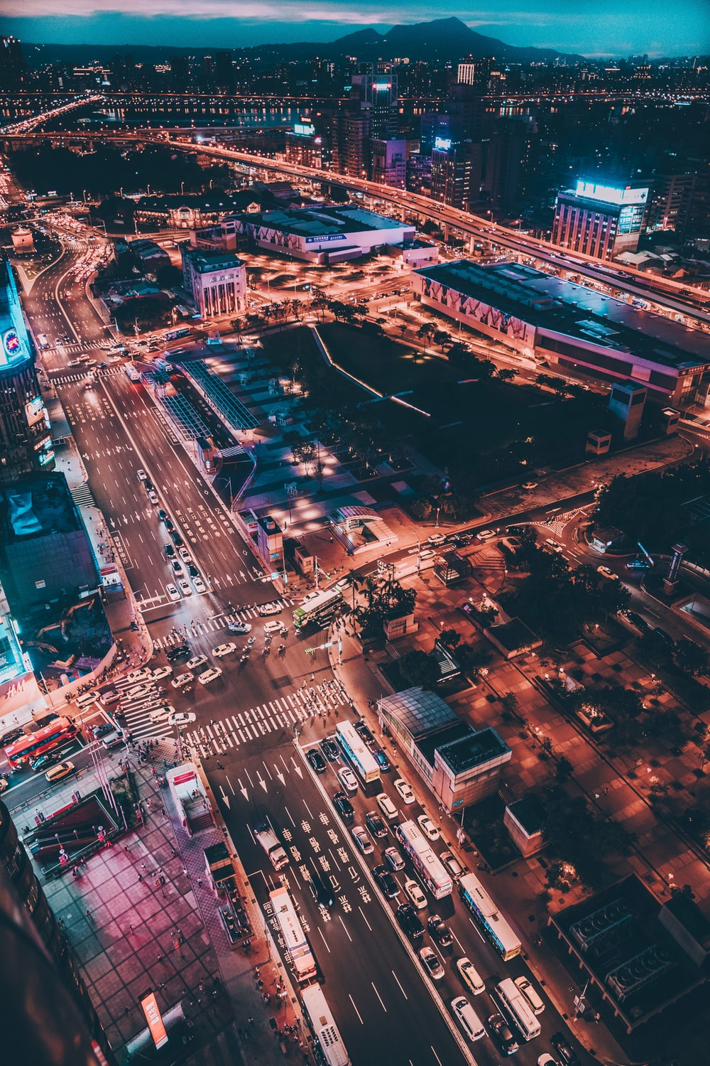 Iphone backgrounds pictures download free images on unsplash drone view of a well lit and busy metropolitan city voltagebd Choice Image