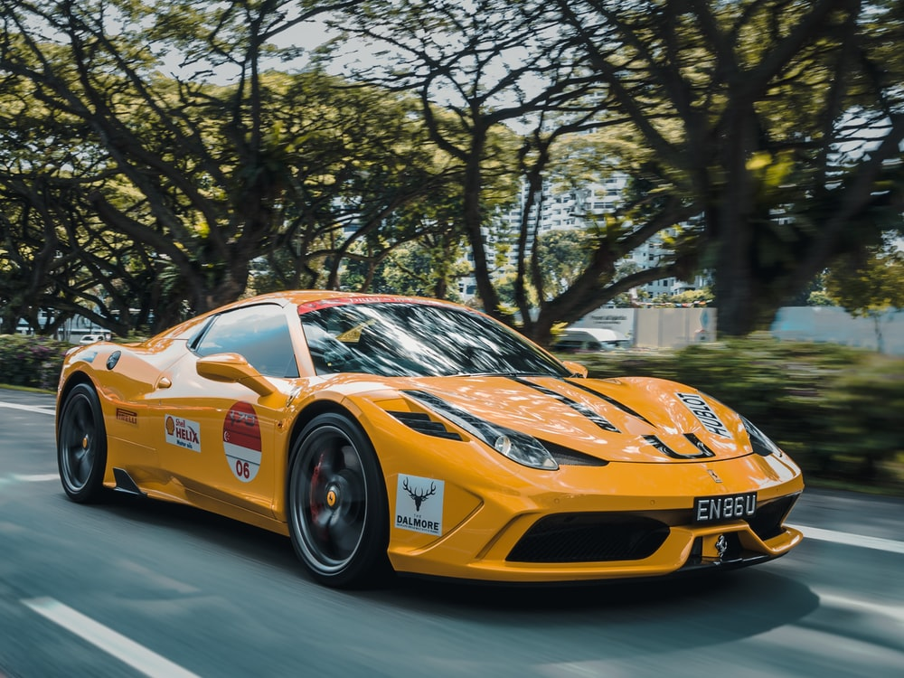 panning photography of Ferrari 458 on road