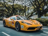 panning photography of Ferrari 458 on road