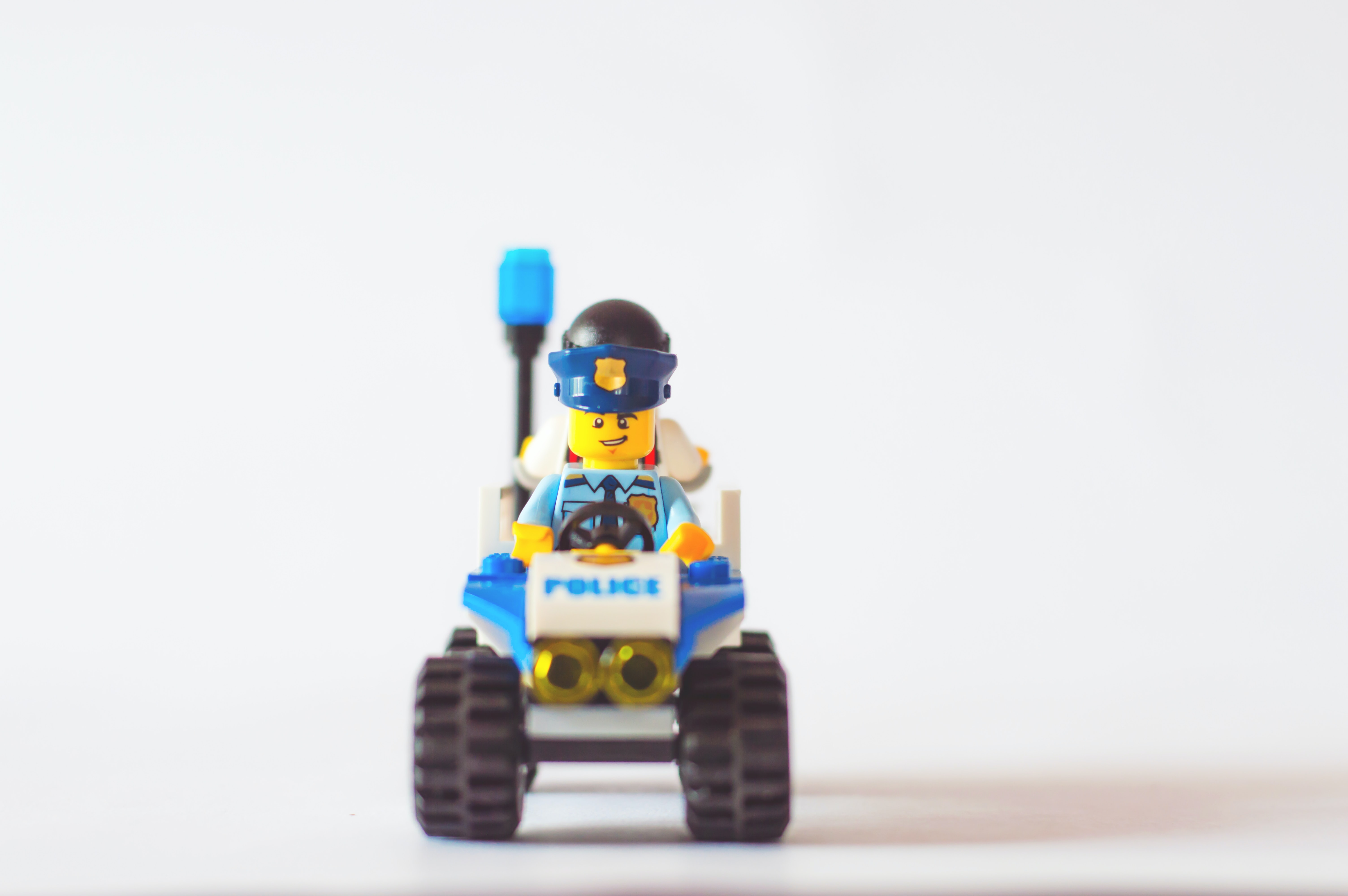 A little Lego character on a Lego vehicle.