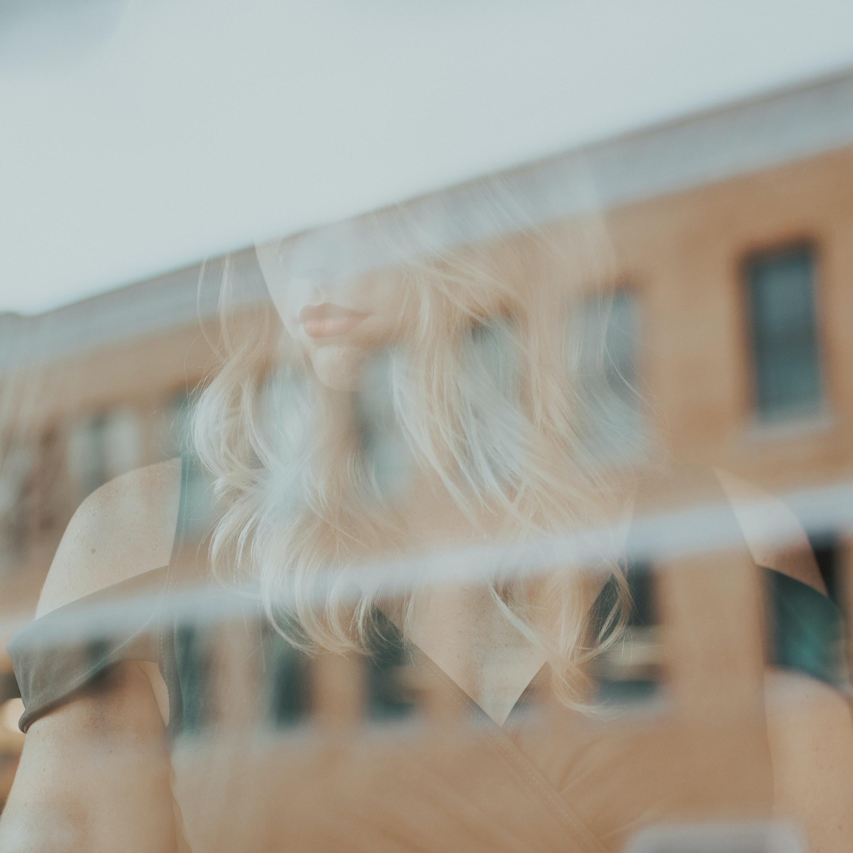 reflection of woman on glass