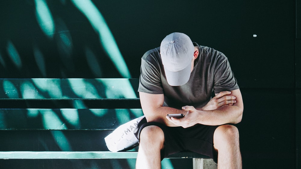 man using smartphone white sitting