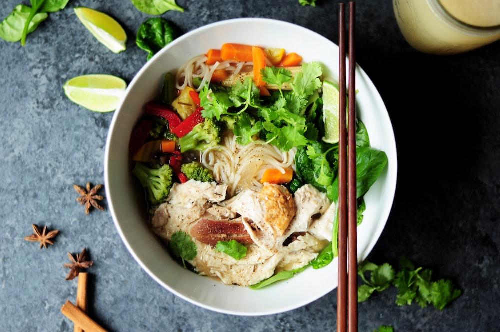 brown chopsticks on white bowl