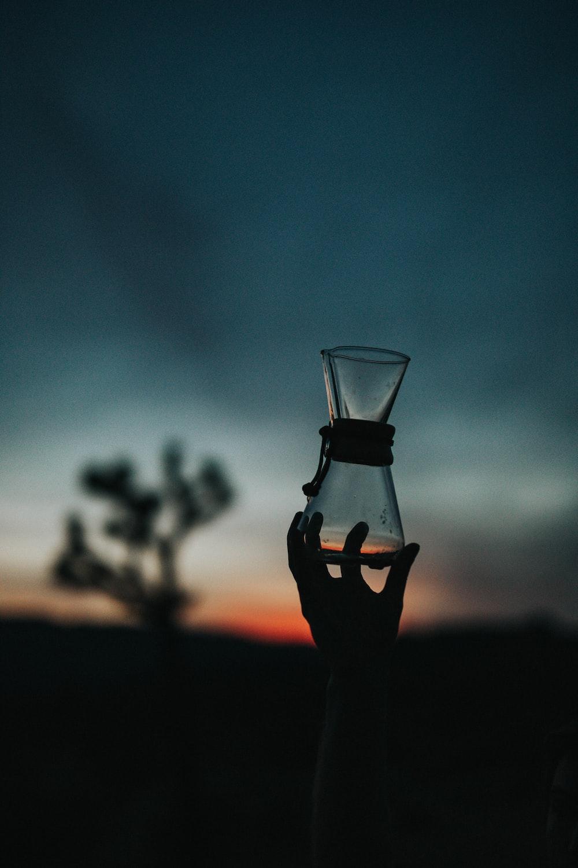 tilt shift lens photography of clear glass vase