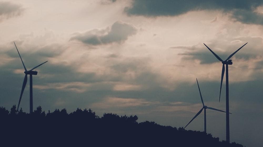 three wind turbines on mountain