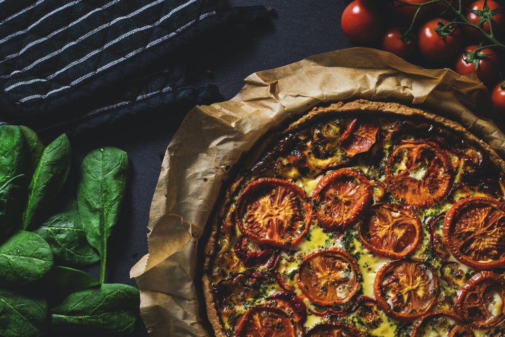 baked tomatoes and cheese pizza