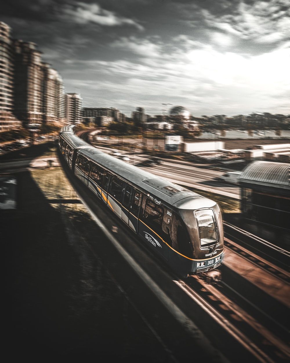 train running on railroad during daytime timelapse photography