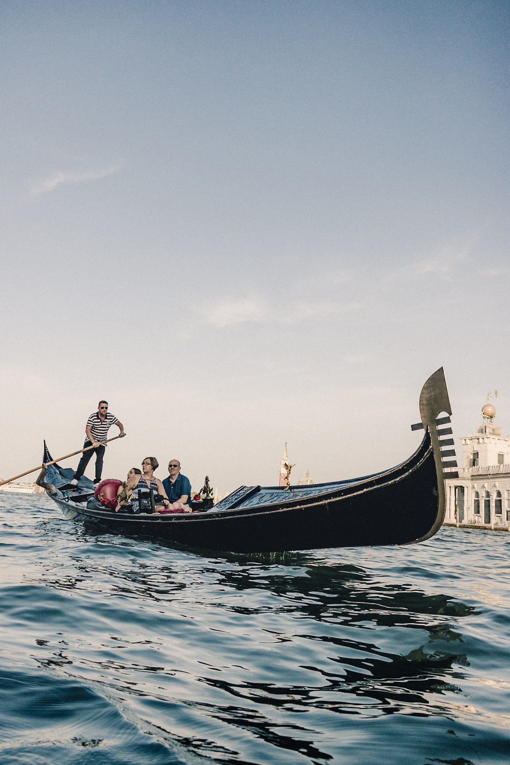 people riding boat on body of water