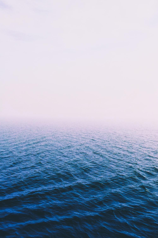 body of water under fogs
