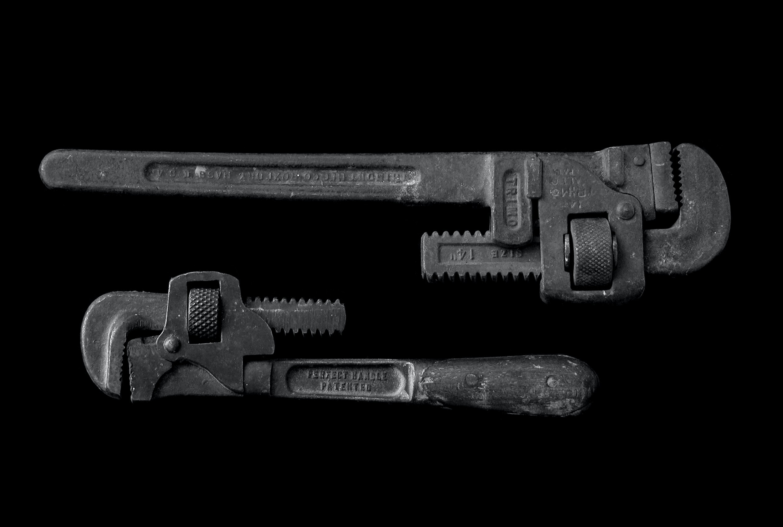two black adjustable pipe wrenches