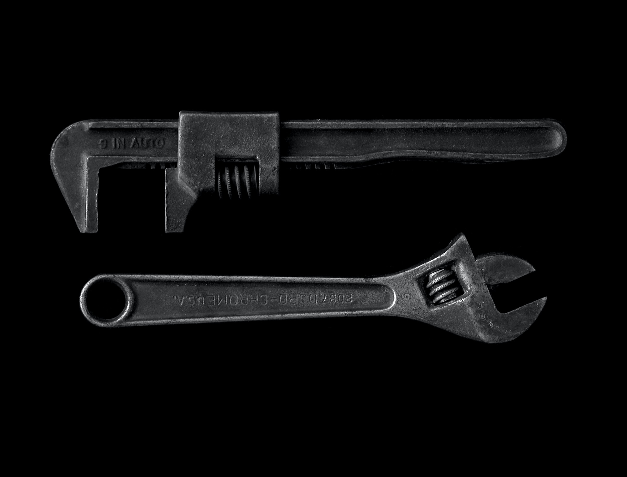 gray adjustable wrench and gray pipe wrench