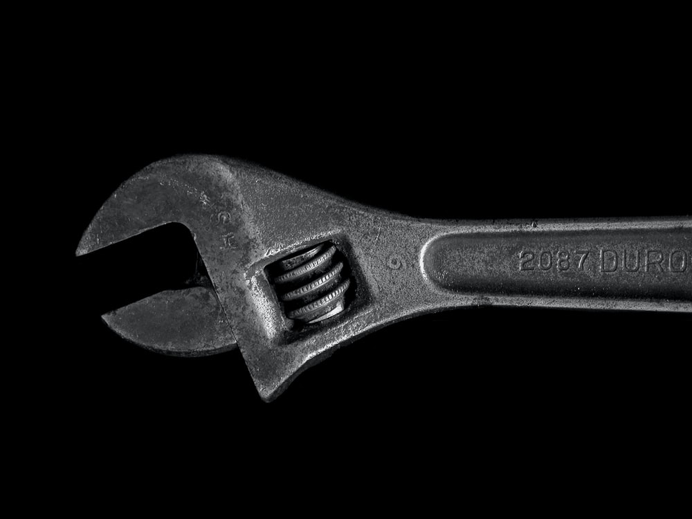 gray metal adjustable wrench