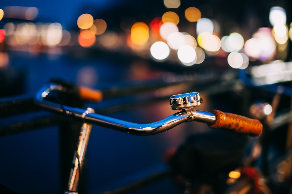 shallow focus photo of stainless steel cruiser bicycle