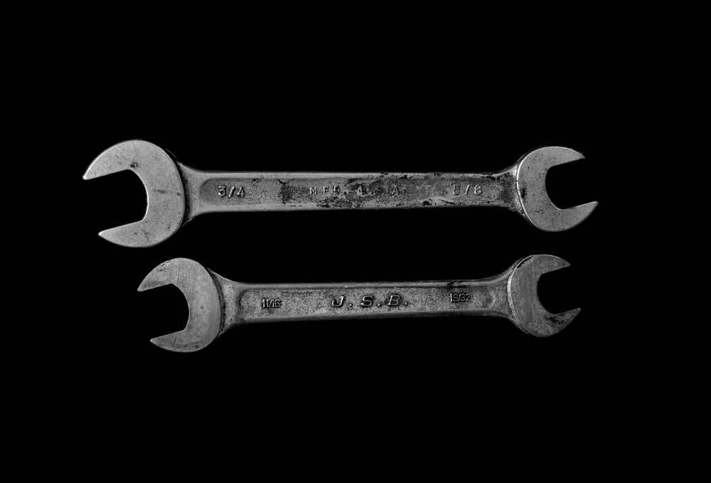 two silver open wrenches