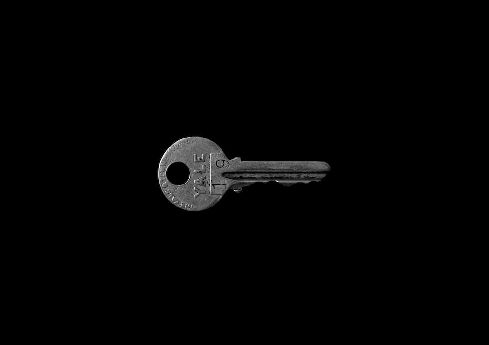 closeup photo of Yale 19 key against black background