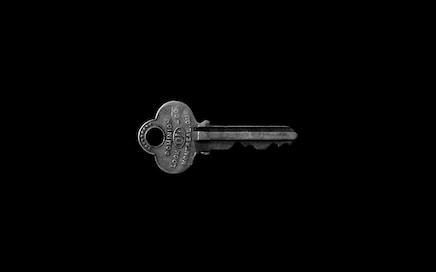 photo of key against black background