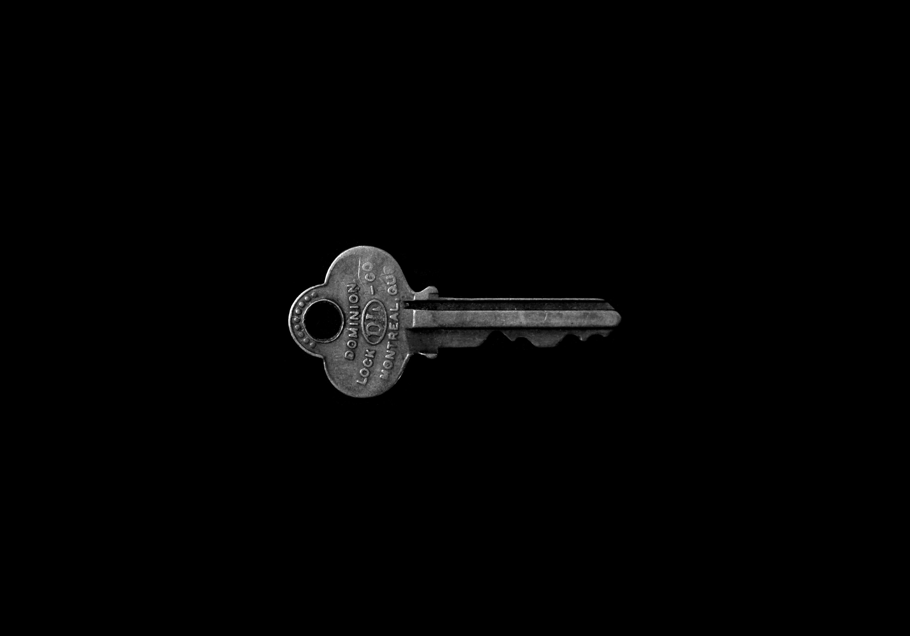 photo of key against black background