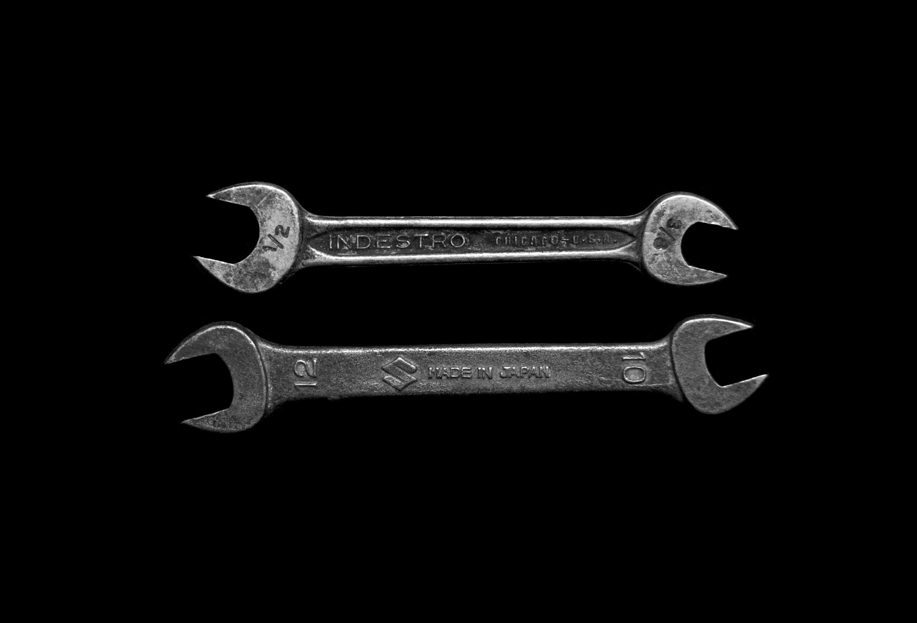 two gray wrenches