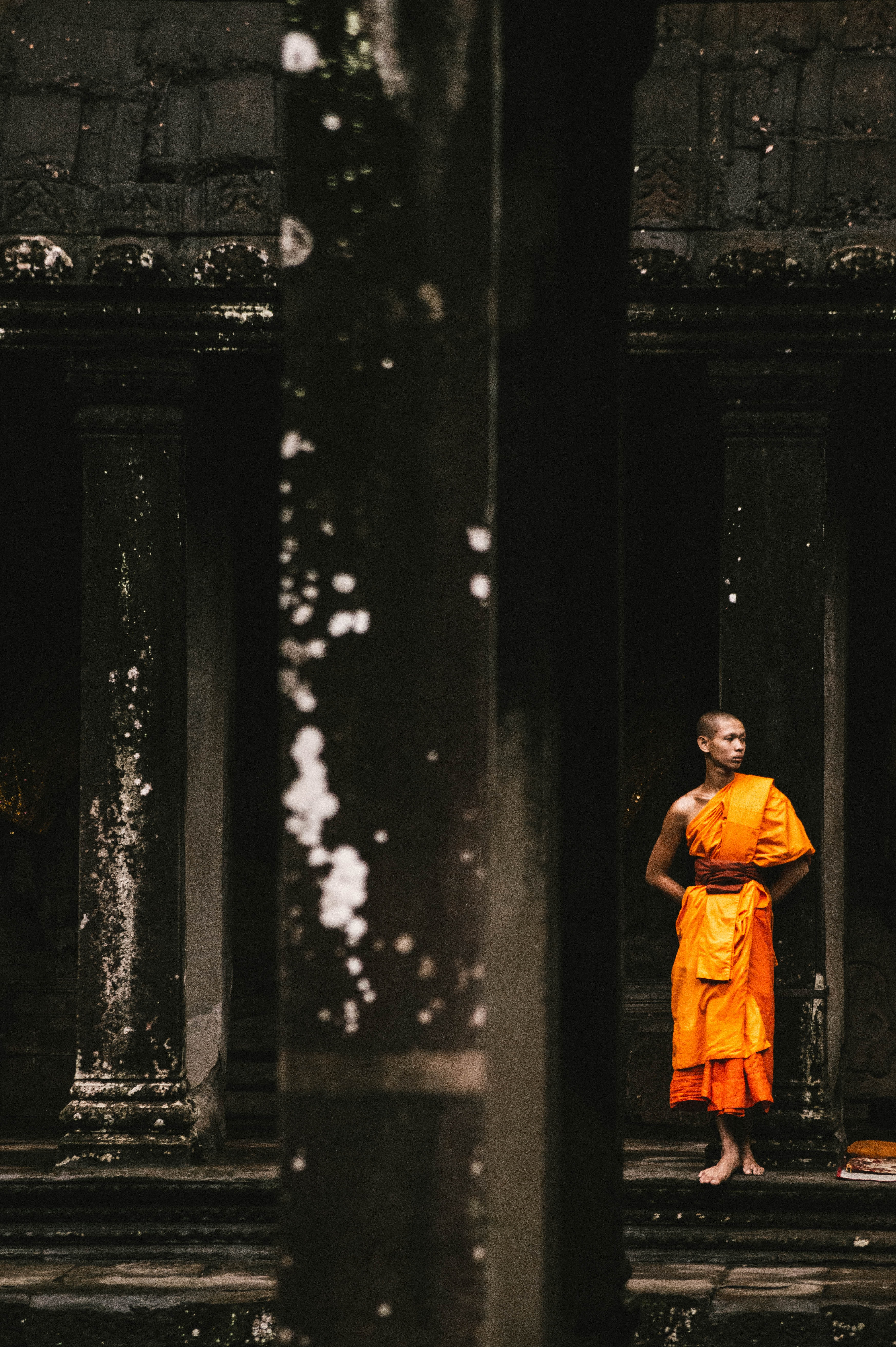 monk standing on a black temple