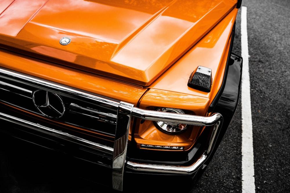 orange Mercedes-Benz car