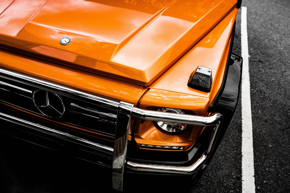 orange Mercedes-Benz car