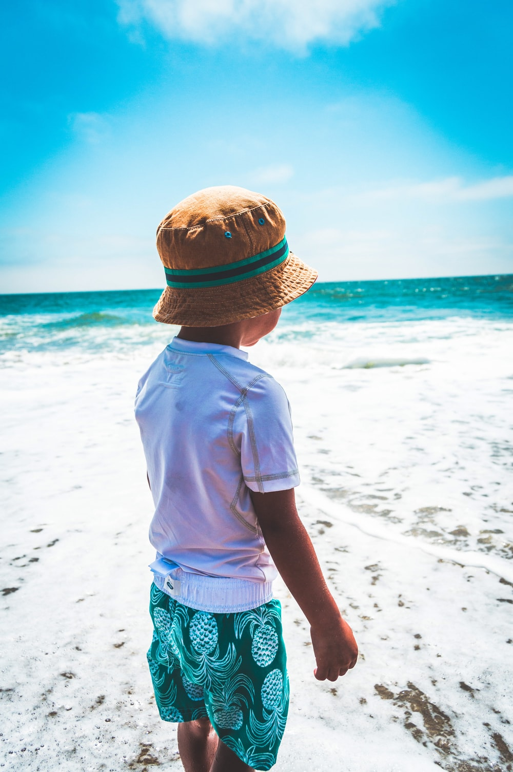 boy wearing brown hat