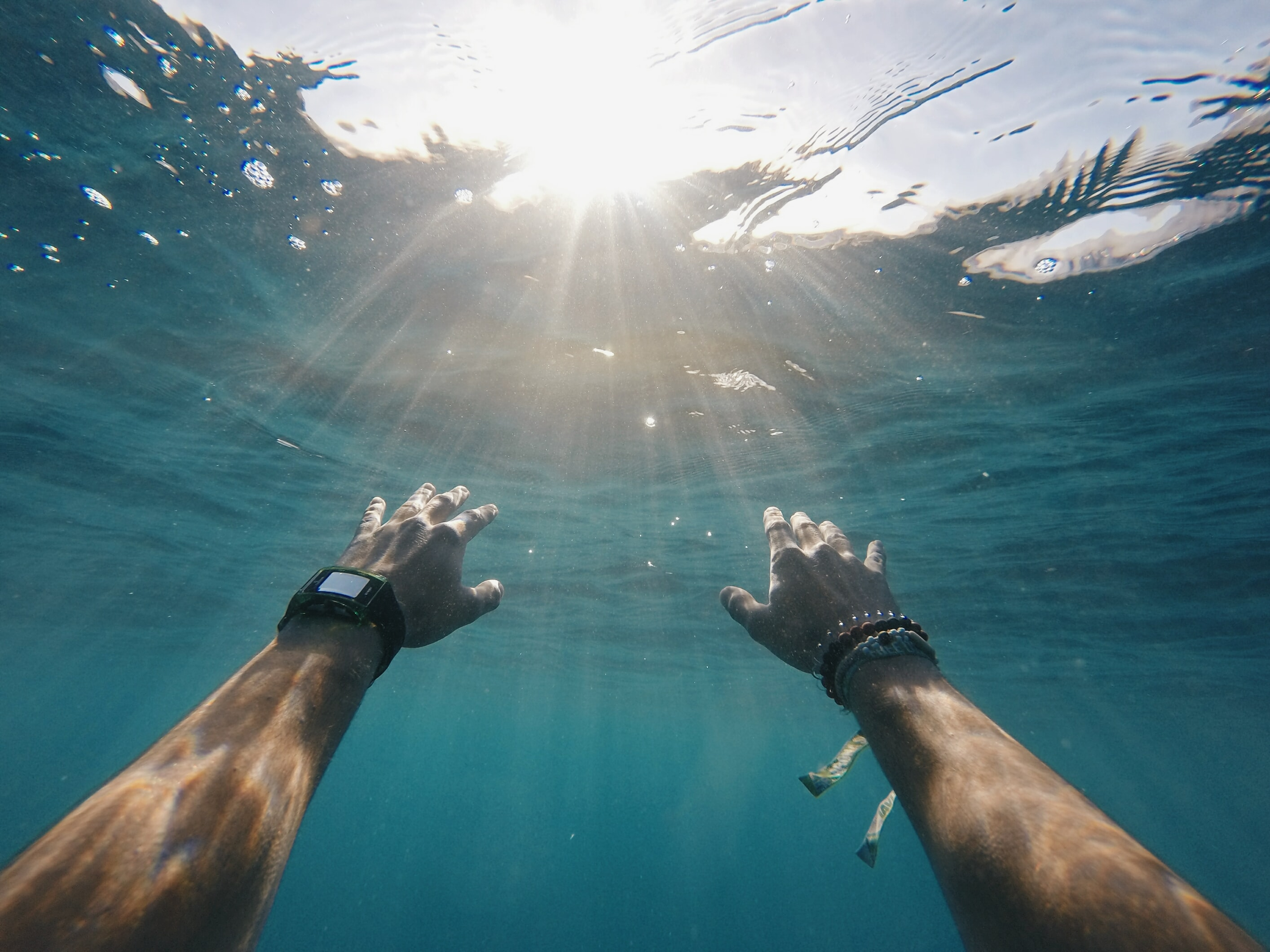 Wearing a smart watch while swimming underwater.