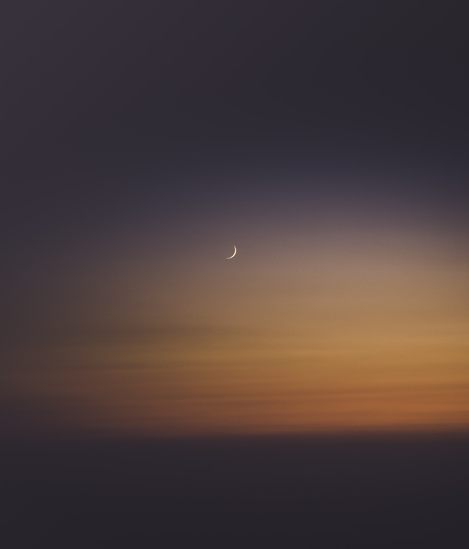 crescent moon during sunset