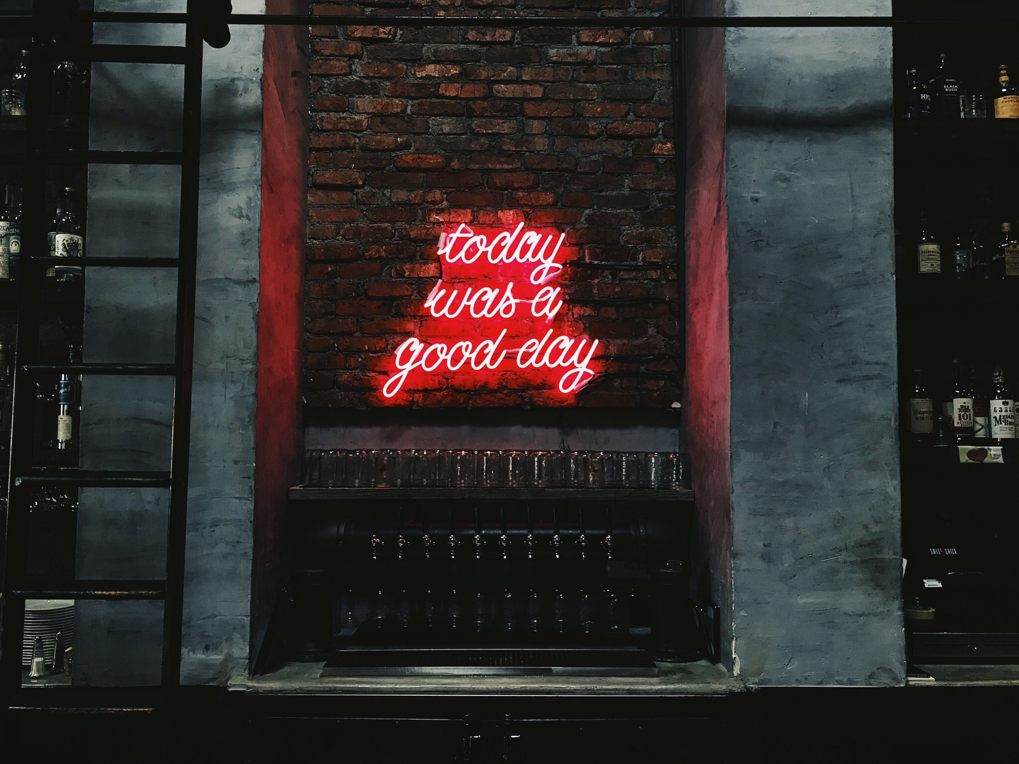 """A red neon light that says """"Today was a good day."""""""