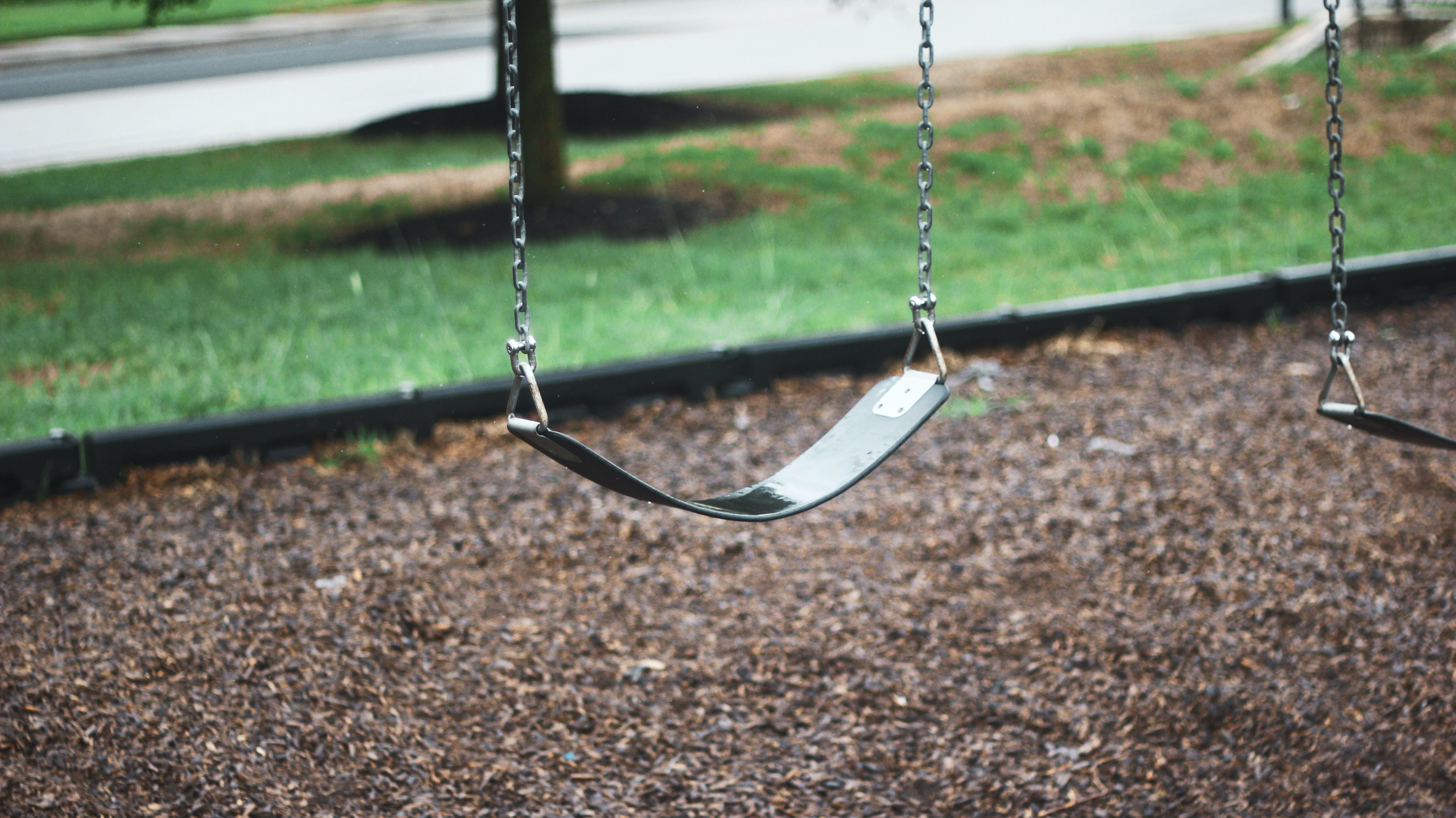 shallow focus photo of playground swing