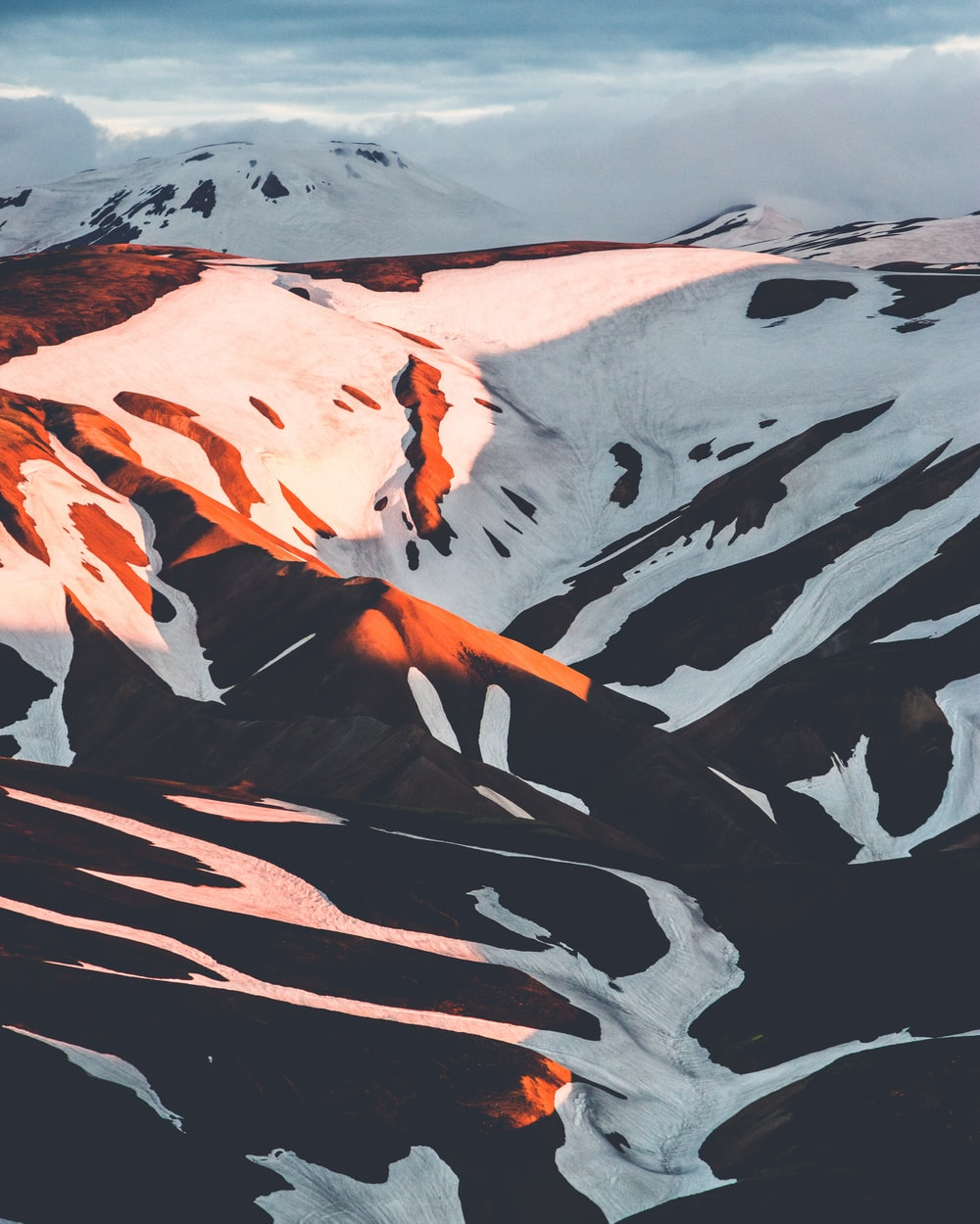 snow capped mountain during golden hour