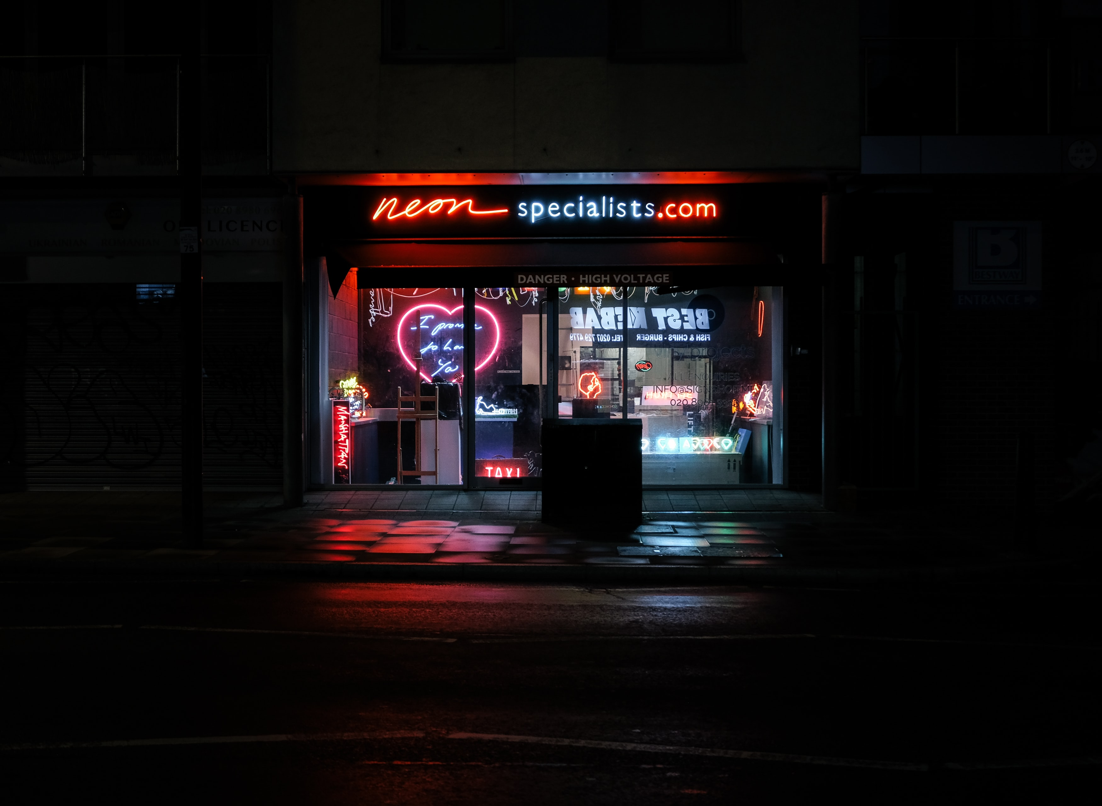 A storefront with a NeonSpecialists.com sign.