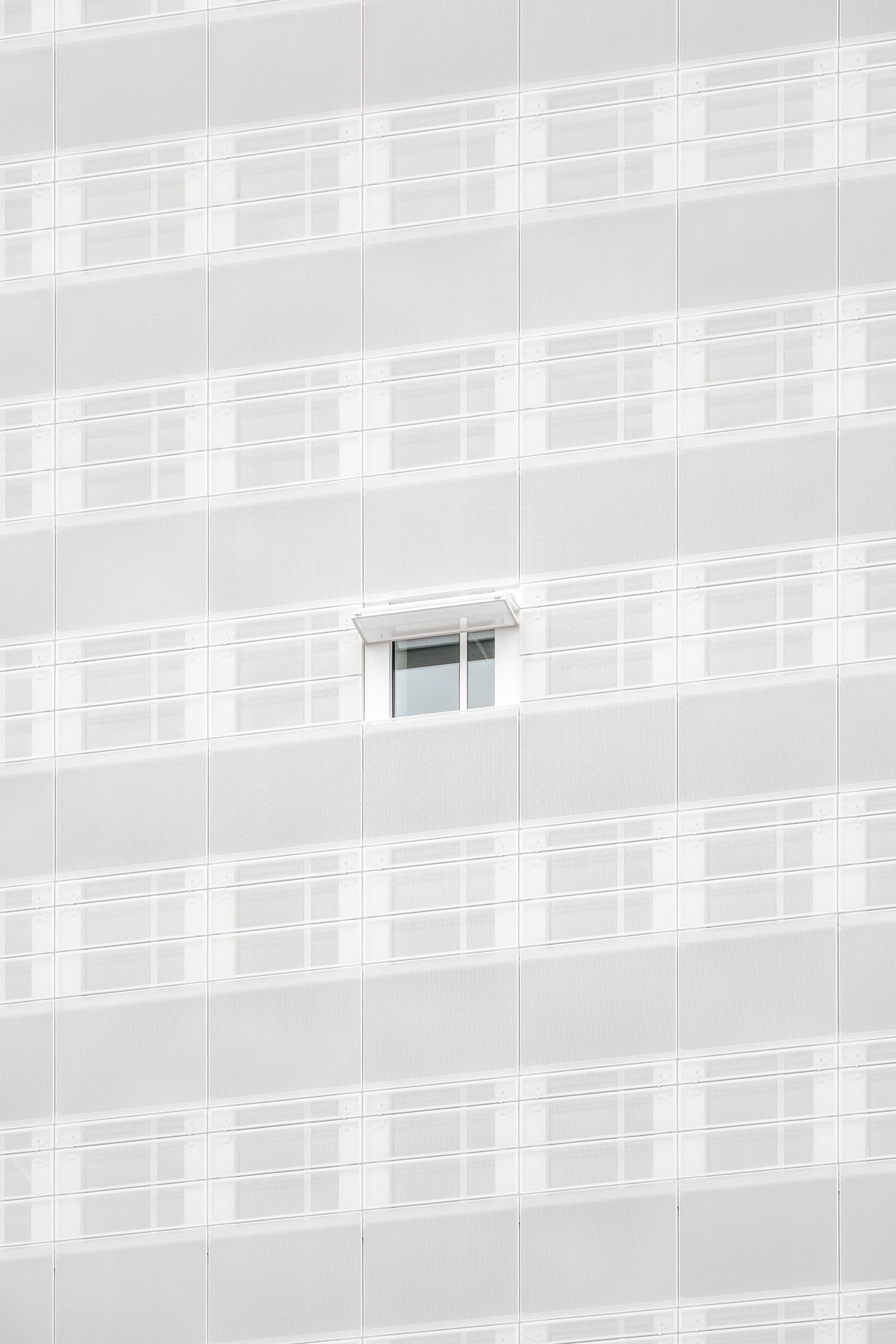 white opened window on building